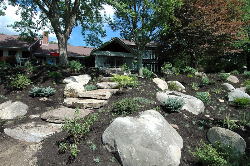 garden soil with rocks and hardscape